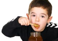 Boy and Honey royalty free stock photo