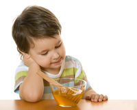 Boy and honey Royalty Free Stock Images