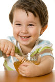Boy and honey Royalty Free Stock Image