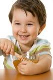 Boy and honey royalty free stock image