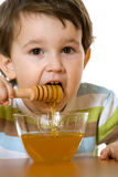 Boy and honey stock photos