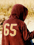 Boy in a hood. Boy in a brown blouse no 65 stock image