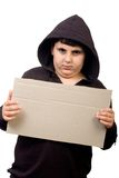 Boy in hood holding banner Royalty Free Stock Photo