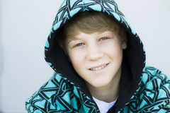 Boy in Hood Smiling To Camera Royalty Free Stock Photography
