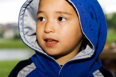 Boy in Hoodie on Rainy Day Royalty Free Stock Image
