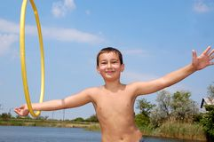 Boy with a hoop royalty free stock photo
