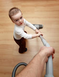 Boy hoovering Royalty Free Stock Photography