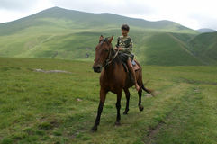 The boy on the horse. Caucasus, summer Royalty Free Stock Photos