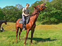 Boy on Horse. The boy on a horse on a wood glade. The horse neighs having lifted a head Royalty Free Stock Photography
