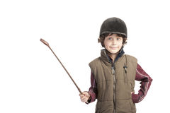 Boy with horse ouTfit and whip Stock Image