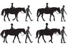 Boy on horse. Boy riding a horse. Horse riding walk Royalty Free Stock Image