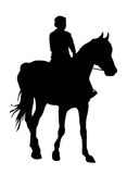 Boy on horse Stock Images
