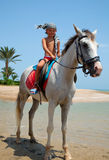 A boy on horseback Stock Photography