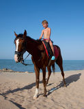 A boy on horseback Royalty Free Stock Image