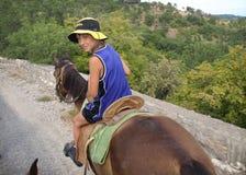 Boy on horseback Royalty Free Stock Photos