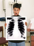 Boy in Hospital. A boy looking at his x-ray in the hospital Royalty Free Stock Photo