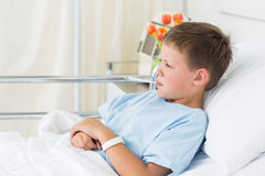 Boy in hospital with thermometer in mouth Royalty Free Stock Photography