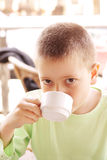 Boy with hot drink Royalty Free Stock Photo