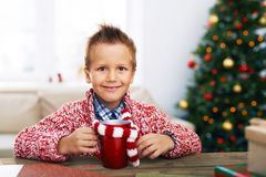 Boy with hot drink Royalty Free Stock Images