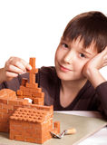 Boy with house. Boy building house isolated on white Royalty Free Stock Photography