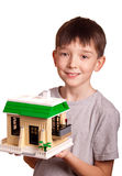 Boy with house. Boy holding house isolated on white stock photos