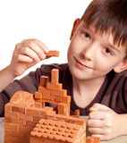 Boy with house. Boy building house isolated on white Royalty Free Stock Photos