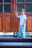 Boy at house entrance Stock Photos