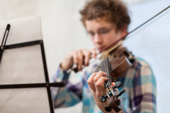 The boy of the house plays a violin Stock Photos