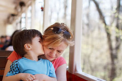 Boy hug mother on train Royalty Free Stock Images