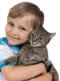 Boy hugging cat Royalty Free Stock Photography