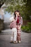 Boy hugging cute sister and looks up Stock Photography