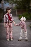 Boy hugging cute sister and looks up Royalty Free Stock Photo
