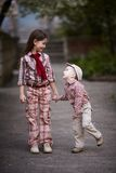 Boy hugging cute sister and looks up Royalty Free Stock Photos