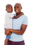 Boy hugging father. Portrait of cute african little boy hugging his father on white background Stock Photography