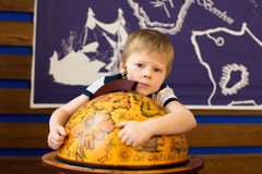 Boy hugging a globe Dreams Stock Images