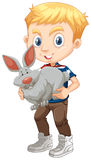 Boy hugging a gray bunny Stock Images