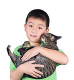 Boy hugging with his cute tiger cat isolated on white background Royalty Free Stock Photography