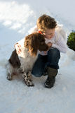 Boy hugging his dog in snow Stock Image