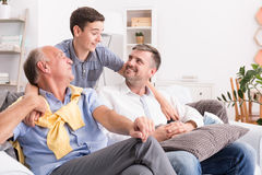 Boy hugging his family. Teenage boy hugging his family at home Stock Photography