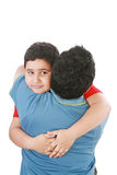 Boy hugging his father. Portrait of a young boy hugging his father against white background Stock Image