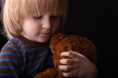 Boy hugging his stuffed toy bear Royalty Free Stock Photography