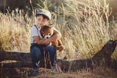 Child with teddy bear royalty free stock photos