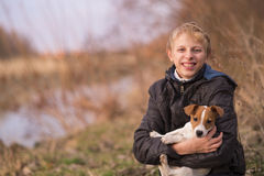 Boy hugging a Jack Russell puppy Stock Photo