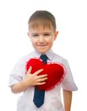 Boy hugging a large toy Royalty Free Stock Image