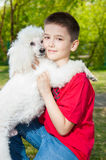 A boy hugs his dog Stock Images