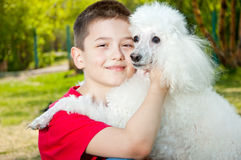 A boy hugs his dog Royalty Free Stock Image