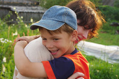 Boy hugs his mother Stock Photo