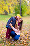 Boy hugs his mother in autumn park Royalty Free Stock Images