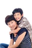 Boy hugs mom affectionately. Asian boy hugs mom in affectionate pose Royalty Free Stock Photo