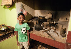 Boy in humble kitchen. In Kandy Sri Lanka Royalty Free Stock Images